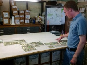 Ryan Germeroth, Transportation Planning and Traffic Engineering Manager for Castle Rock looks at a new neighborhood map in need of signage